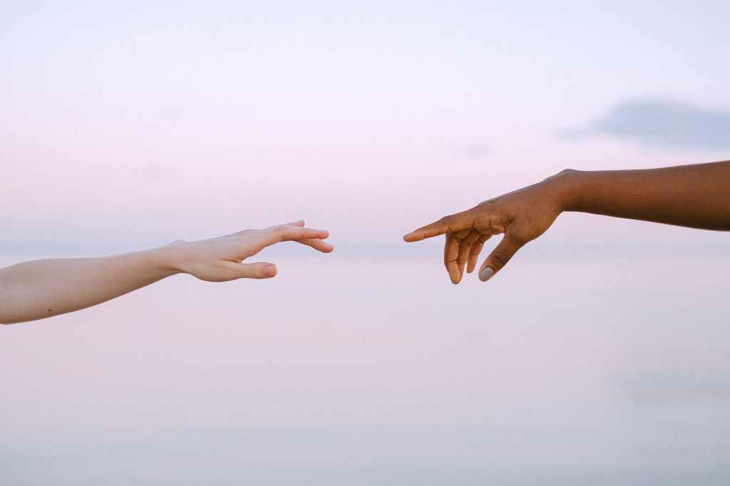 Hands reaching for unity.
